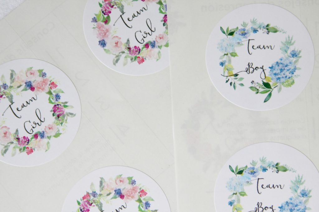 Floral team boy and team girl stickers to use for a gender reveal party that has a fun modern color-scheme of navy and blush.