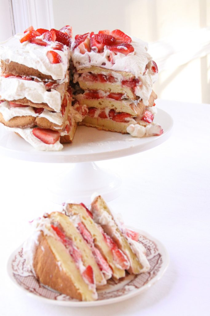 gluten free strawberry shortcake with basil whipped cream sliced for summer entertaining