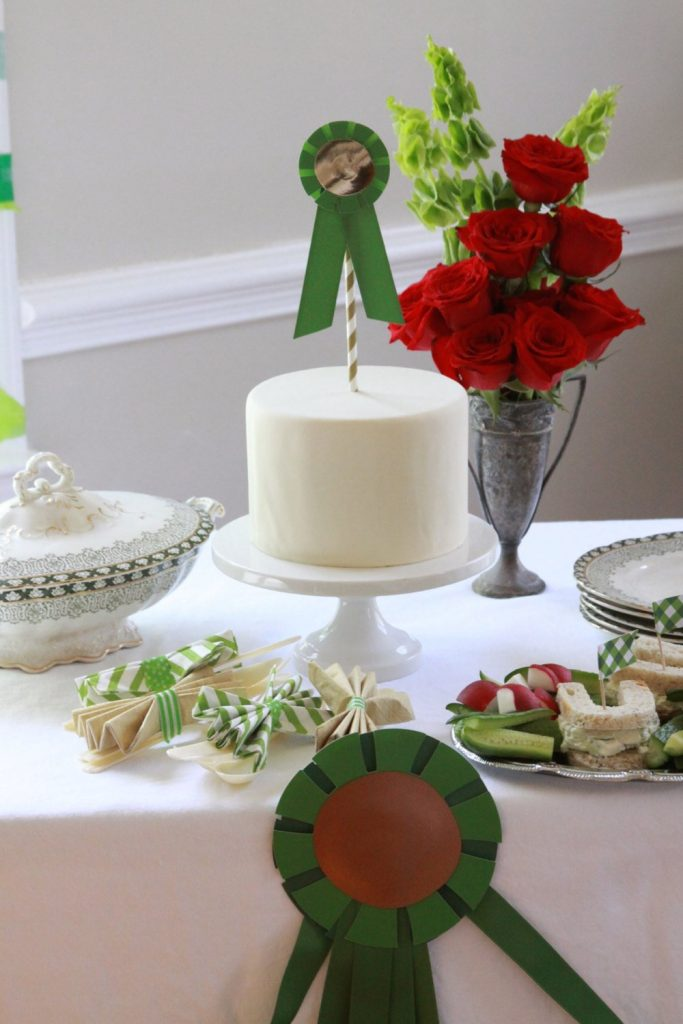 Derby party buffet table with horse show ribbon garland on table