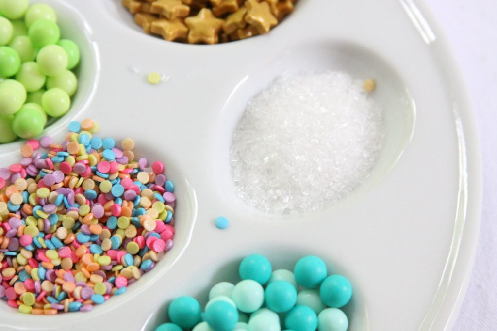 Ingredients and special sprinkles for Unicorn Bark a fun DIY party favor