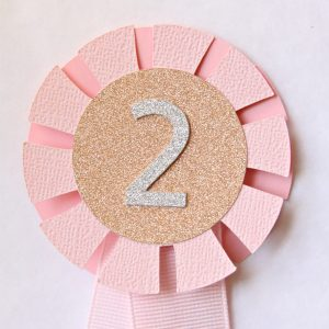 Pink Pony Cake Topper with a sparkly number 2 in silver on rose gold
