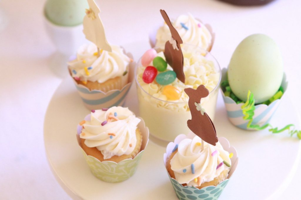 East brunch ideas - cute little bunny toppers on miniature cupcakes for a fun display.