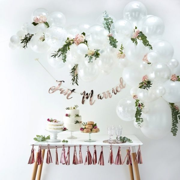 White Balloon Garland Kit that coordinates beautifully with coral red paper products. Perfect for above a dessert table.