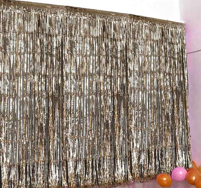 Gold fringe photo booth backdrop of virtual party backdrop