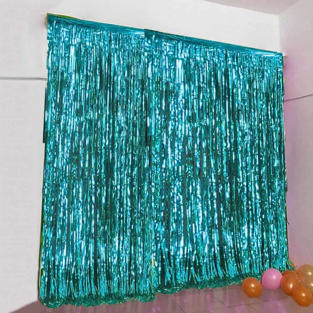 Teal Fringe Photo booth backdrop for a baby it's cold outside baby shower.