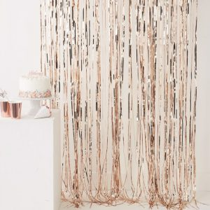 Rose gold fringe backdrop curtain for a photo booth