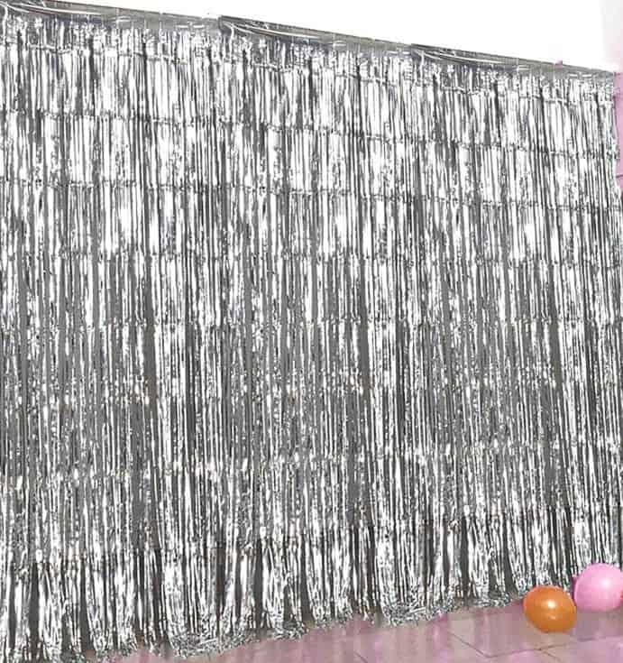 Silver fringe backdrop curtain for a winter party backdrop