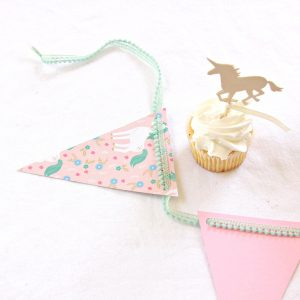pom pom banner with unicorn theme