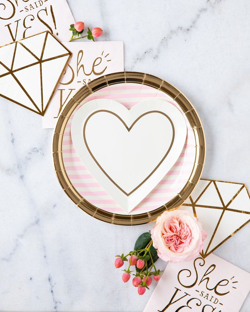 pink and gold striped plates, layered with sweet gold heart shaped dessert plates, surrounded by She Said Yes Napkins and diamond-shaped cocktail napkins