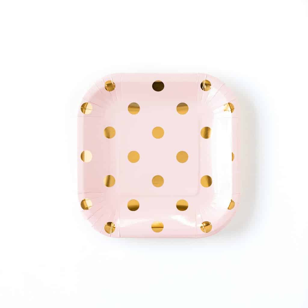 Pink square plates with gold foil polka dots for a Princess Party Idea