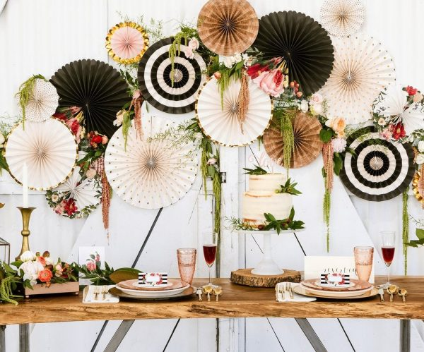 Floral Bridal Shower Photo Backdrop in Black, Cream, Kraft and Gold behind a cake.