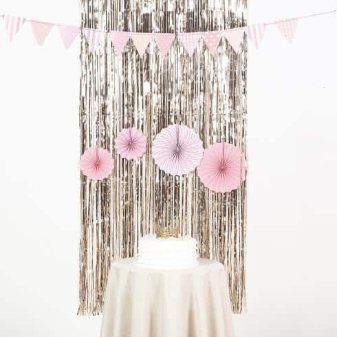 Gold fringe backdrop curtain for a little girl's birthday party