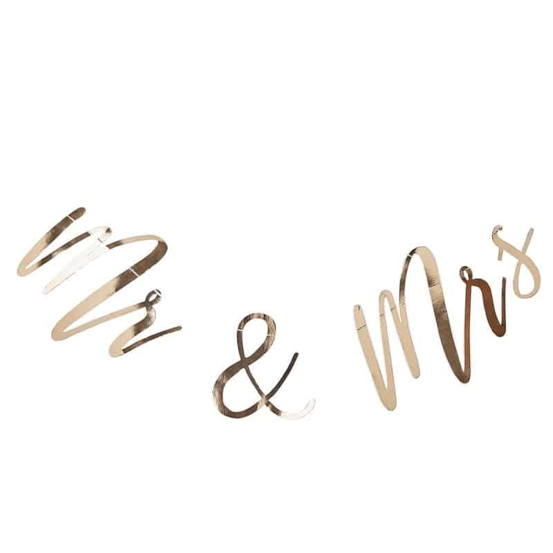Gold Mrs. and Mrs backdrop banner made of gold foil.