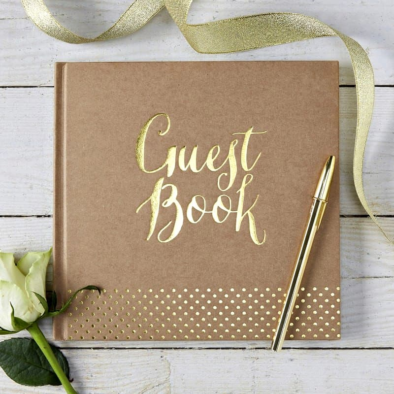 Kraft brown guest book with a gold foil guest book cover imprint.  This is a perfect guest book for a fall or winter wedding.