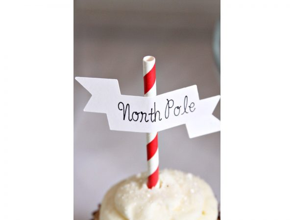 North Pole Cupcake Topper on a cupcake with sparkly sprinkles