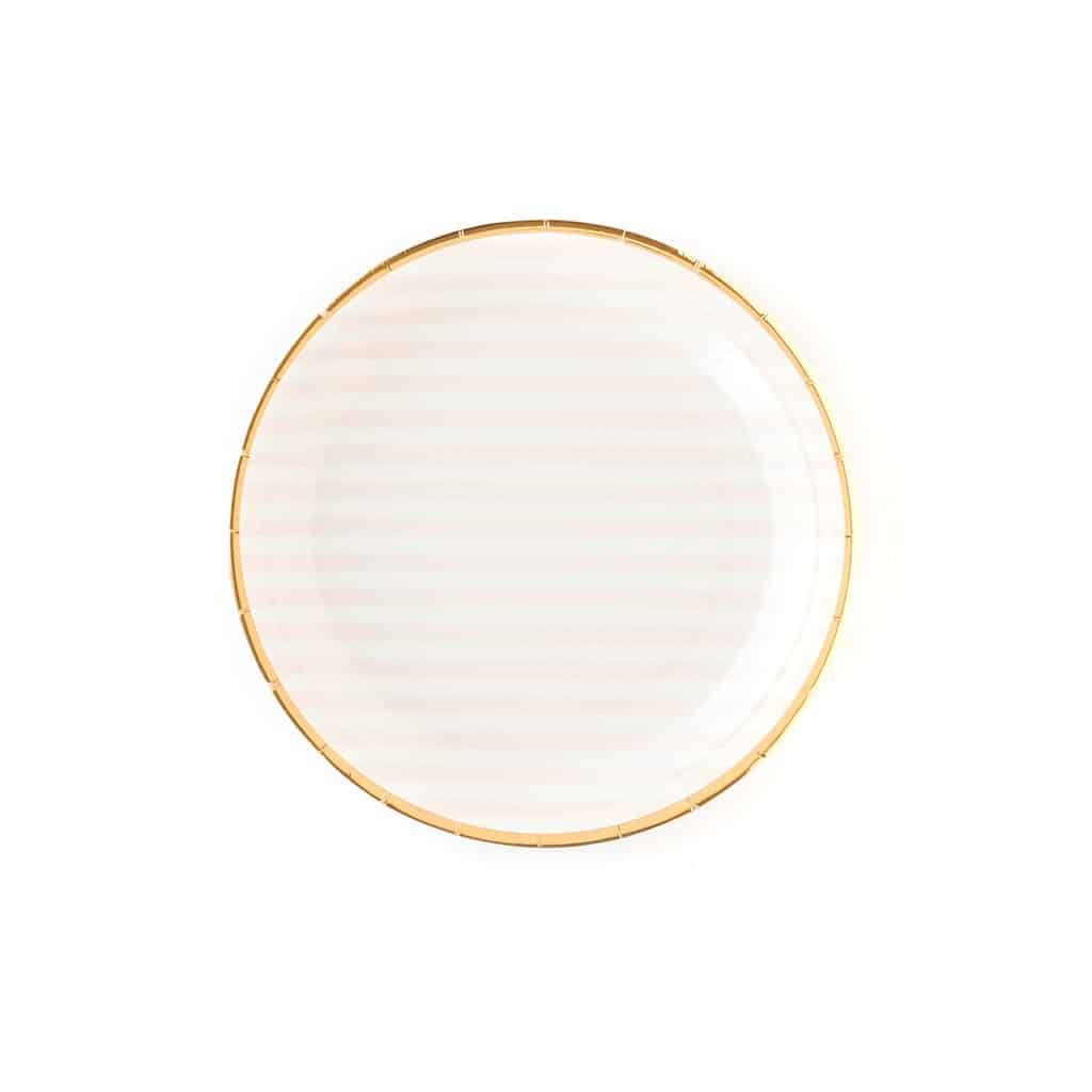 Round soft pink and white striped paper plates with a gold foil accent edge for little girl princess party tableware.