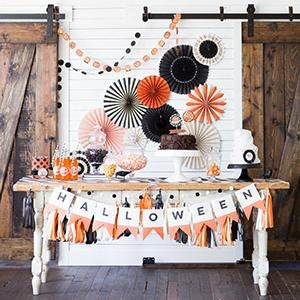 Halloween party display with orange and black pinwheel for fall entertaining
