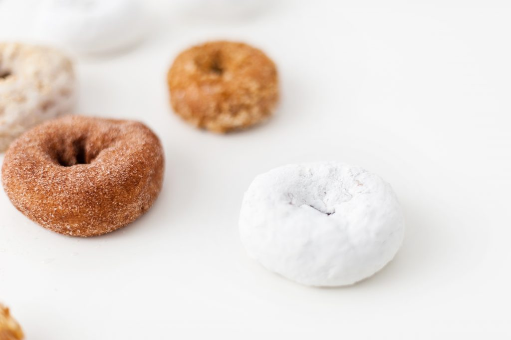 powdered donuts, cake donuts and cinnamon sugar donuts to create a Fall Donut Wall display