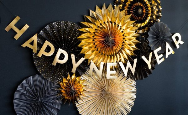Happy New Year Banner over black and gold party fans
