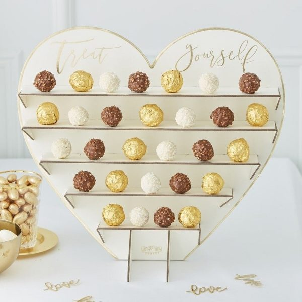 Candy bar treats stand with gold treat yourself on the top
