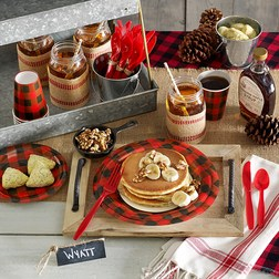 Serve little flapjacks and serve coffee or hot chocolate - fun ideas for a lumberjack first birthday party breakfast spread - shown on our red and black buffalo plaid tableware.