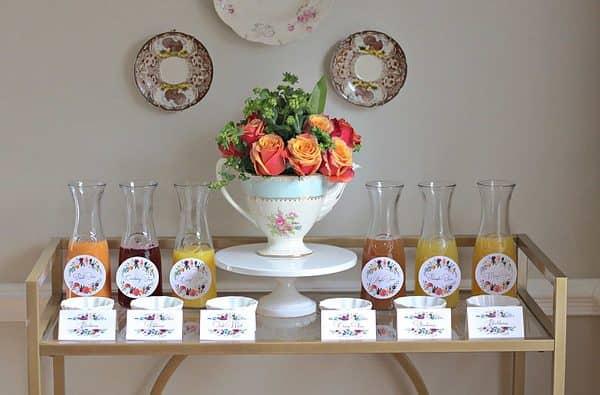 Mimosa Bar Fruit, juices and floral arrangement for a spring bridal shower
