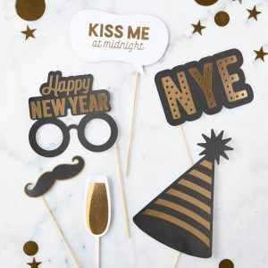 New Year's Eve photo booth props for a glamorous selfie station at the NYE 2020 party