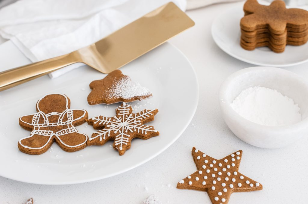 Royal icing on christmas cookie cutout and gingerbread men
