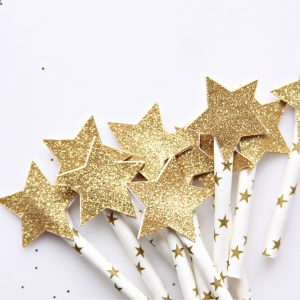 Gold glitter star cupcake or cake toppers on celestial star picks