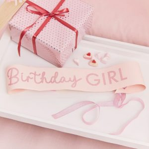 Blush Little Birthday Girl sash with pink glitter words. Pink sheer ribbon to tie.