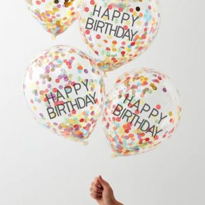 Brighten up the room with these rainbow confetti-filled Happy Birthday confetti balloons to create an amazing rainbow theme party!