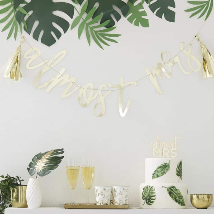 Almost Mrs. Tropical Bridal shower theme complete with palm leaves and elegant gold accents.  Perfect for a summer bridal shower - all available from the EnFete Party Shop.