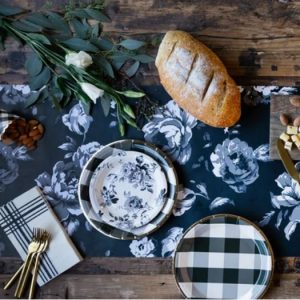 Farmhouse Table Runner made from paper printed with bold cabbages roses - black background with cream colored floral design