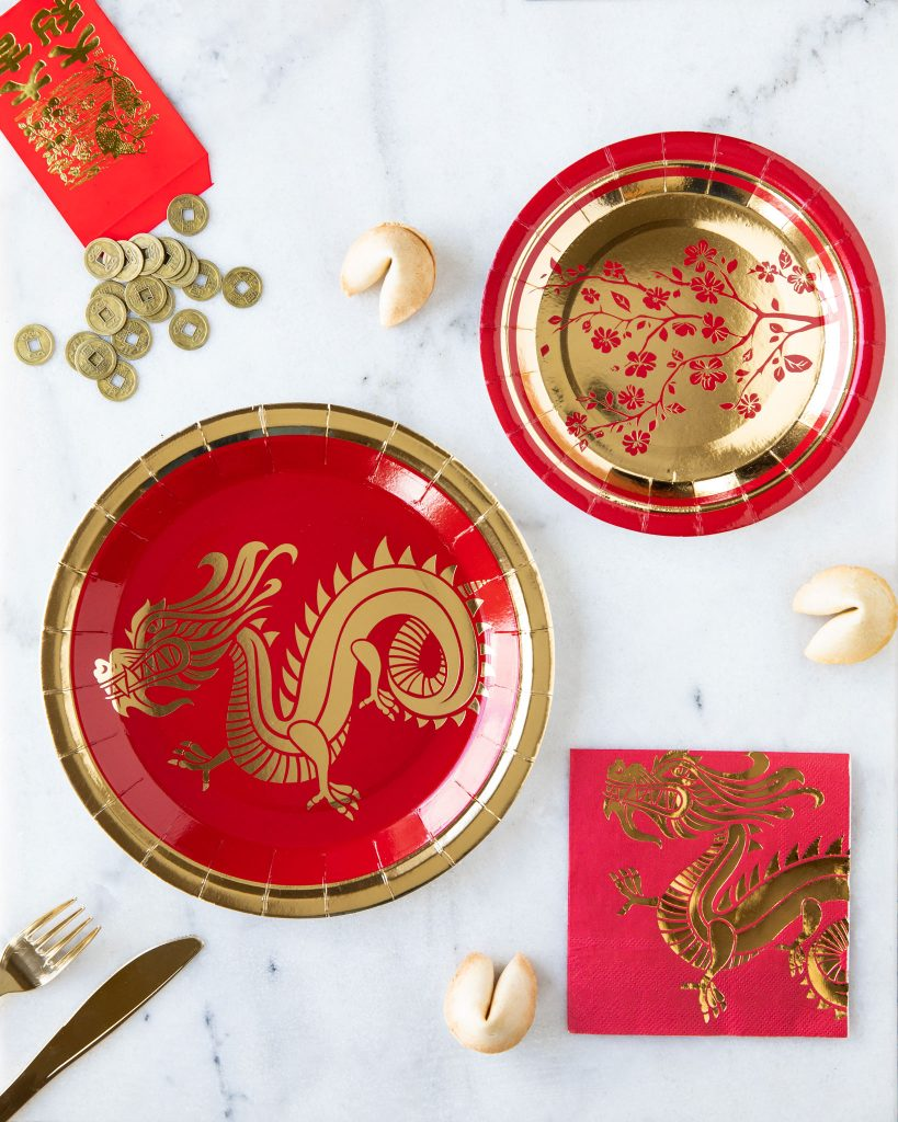 Chinese New Year Plates, napkins and red envelope on a table for a Lunar New Year Celebration.