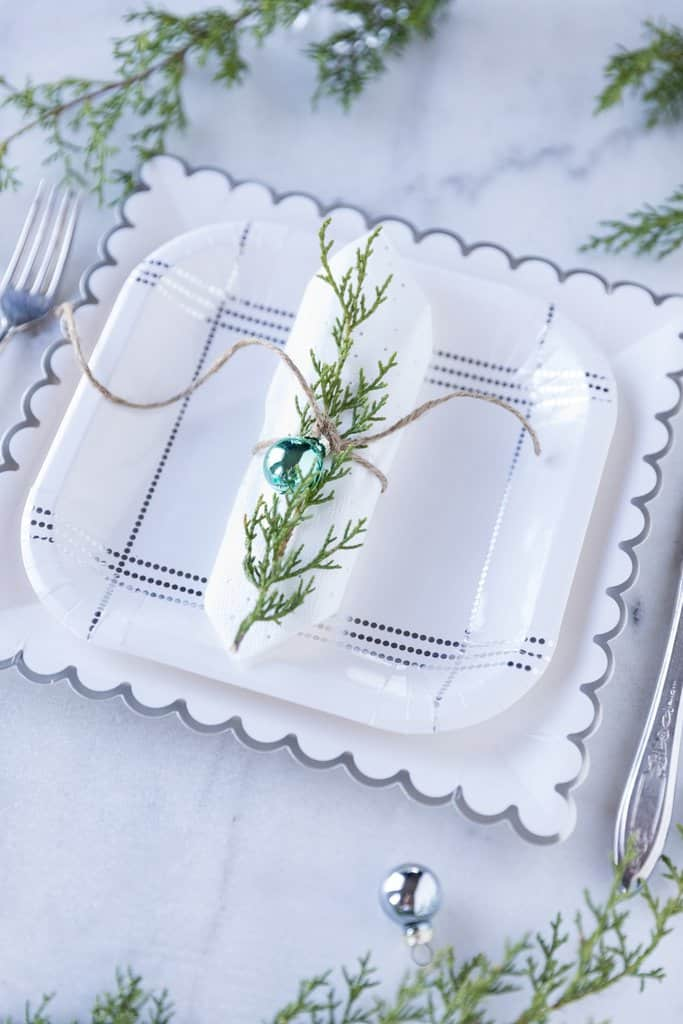 Silver and white sparkling paper tableware for a Baby It's Cold Outside Baby Shower