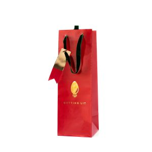 Getting Lit Red Wine bottle bag with a gold foil christmas bulb printed on the front