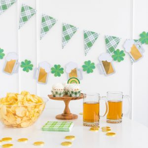 Alternating shamrocks and beer mugs with gold foil on a banner for St. Patrick's Day Decorations.