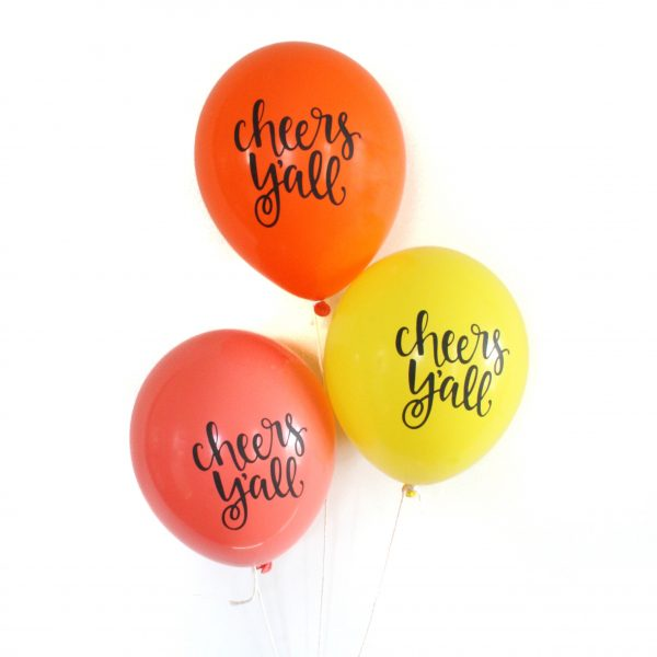 Cheers Y'all balloons in citrus colors - orange grapefruit and lemon shades