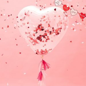 Heart Shaped Clear Confetti ballon with red foil heart confetti inside and a kit to make balloon tassel tails in red and pink