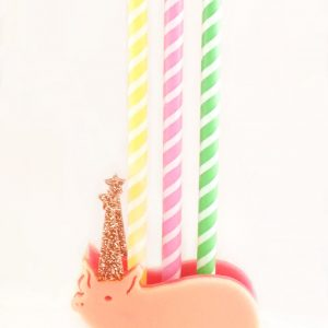 Party Pig Candle Holder in pink acrylic that holds up to 3 birthday candles. Pig has an adorable glitter party hat